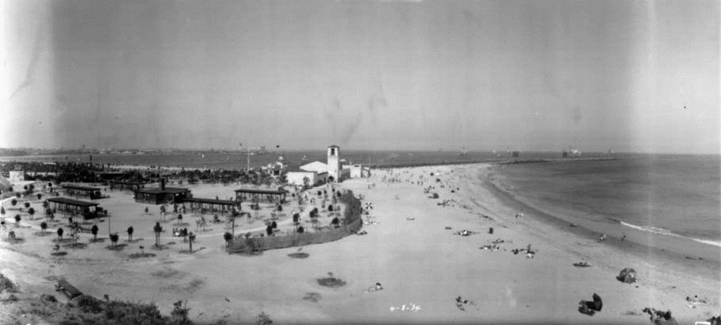(1934) -  Panoramic view of Cabrillo Beach in San Pedro on April 8, 1934. The beach is divided into two curved strands, one on each side of the breakwater. In between the two stretches of sand is a picnic area and the Cabrillo Beach Bath House. (photo courtesy Water and Power Associates)