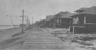 The PE trolley tracks, boardwalk, beach cottages, and old iron pier - circa 1913; photo courtesy Manhattan Beach Historical Society